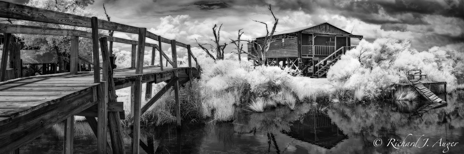 Isle de Dean Charles, Louisiana, Bayou, Fish Camp, Shack, Bridge, Disappearing, reflections, coast, stormy, panorama, photograph, black and white