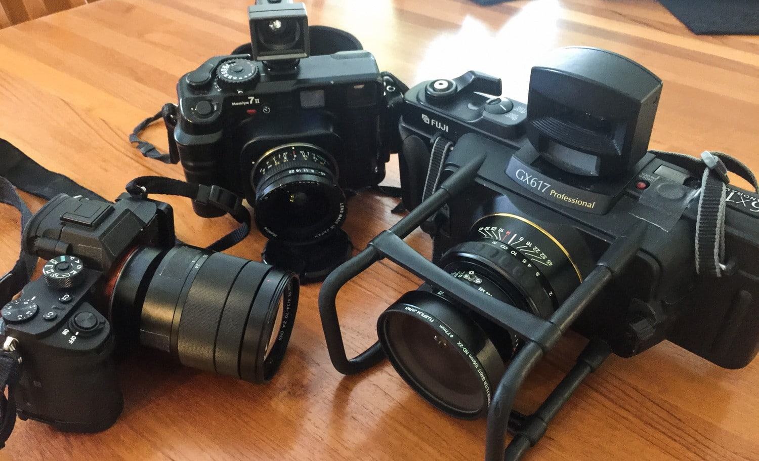 The Sony A7Rii with 24-70,, Mamiya 7ii with 43mm, and Fuji GX617 with 105mm attached.